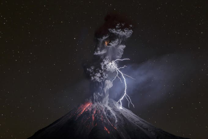 Colima Volcano in Mexico shows a powerful night explosion with lightning, ballystics and some incandescent rockfalls. Photo taken on dec. 13 at 22:24 hours, 12.5 km away from the crater near a lagoon named Carrizalillos on Comala municipality in the state of Colima. Colima Volcano had a period of enormous activity on july of 2015, at least 700 inhabitants were evacuated from their settlements. The volcano mantains activity with 3 to 6 explosions by day. Lightning on Colima Volcano explosions became common on last months. This particular lightning is more than 600 meters long, so the big light made clear some details of the south portion of volcano. It's an 8 seconds shot, time enough to catch the explosion and the lightning. Photo: Sergio Velasco