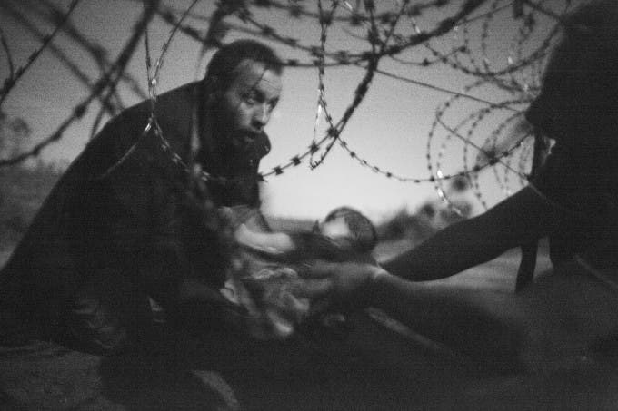 Migrants crossing the border from Serbia into Hungary. World Press Photo Winning Image from Australian photographer Warren Richardson
