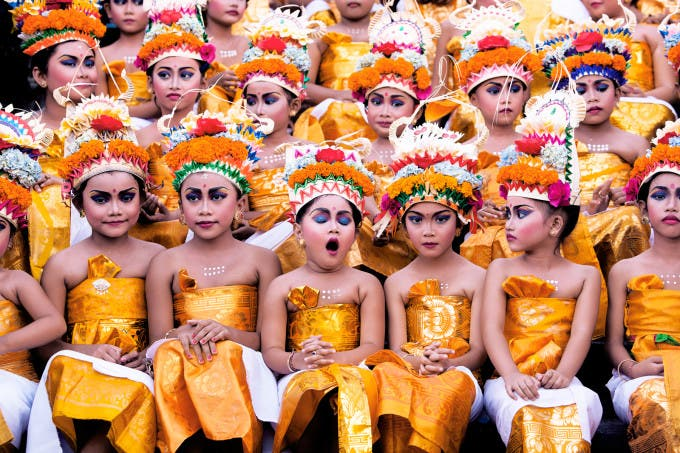 Image was taken in Bali during Melasti Festival. This Festival is conducted once a year in conjunction with Nyepi or Silent Day. These young girls were waiting for their turn to perform. They looked stunning with their bright coloured costumes and heavy make-up on, however the expression on each of the girls' face especially the yawning girl gives this image an extra 'ummpph'. ©Khairel Anuar Che Ani, Malaysia, Shortlist, Open, Split Second, 2016 Sony World Photography Awards