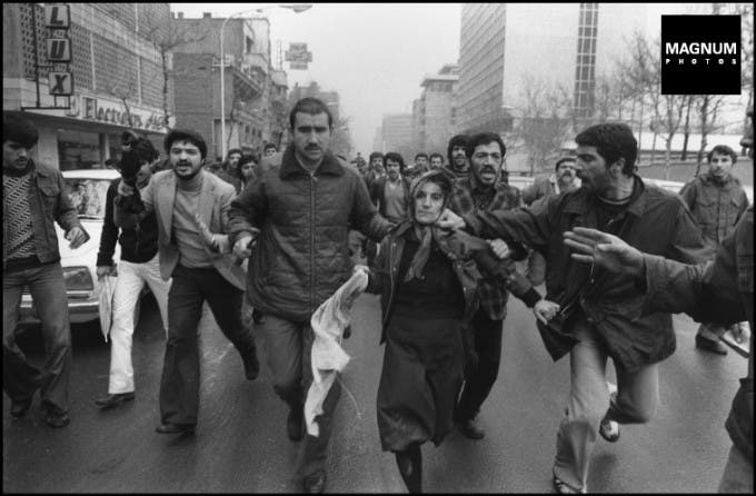 IRAN: TEHRAN January 1979. After a pro Shah demonstration at the Amjadiyeh Stadium, a woman believed to be pro Shah supporter is lynched by a Revolutionary mob.