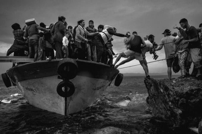 Lesbos, Greece. A boat with more than 150 persons on board is just arrived from Turkey. Often these boats can make two or three trip a day. © Gianluca Panella