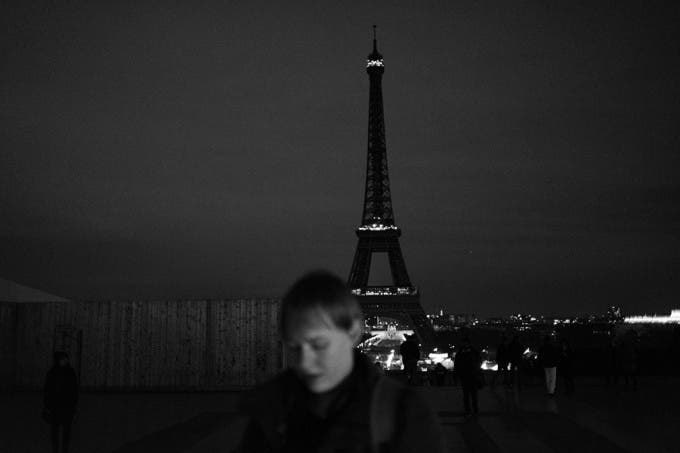 Eiffel Tower turns out its lights as mark of respect to victims.