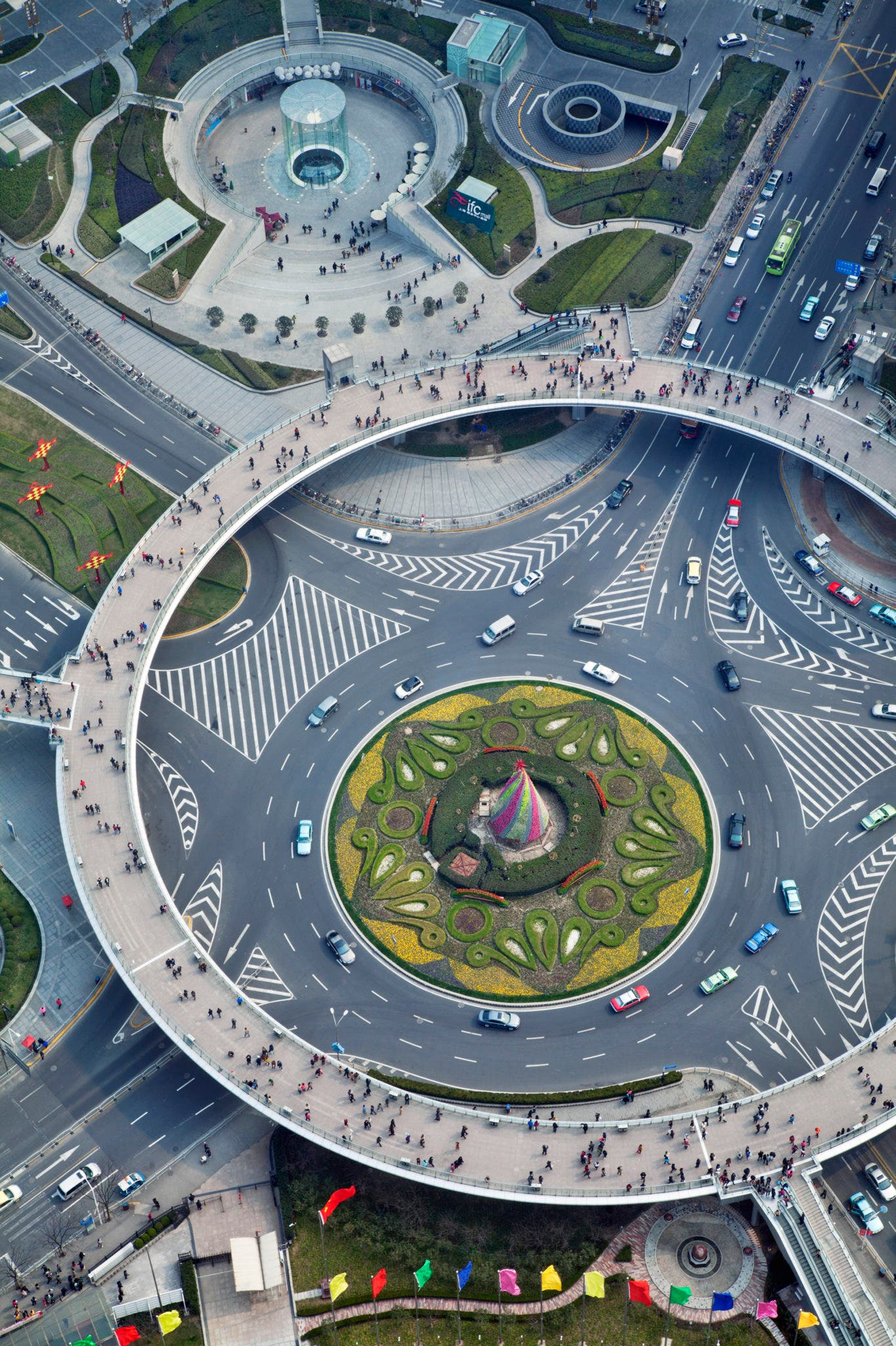 Photographed through the spherical glass floor of the Oriental Pearl Tower, an enormous roundabout functions as ornament and traffic control in the financial heart of Shanghai.