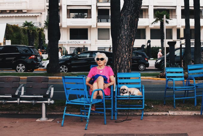 Taken in Cannes, France 2015. I took this photograph on Promenade de la Croisette, during my summer holiday. Whilst everyone is mostly new wealth, this woman stood out, as she is relatively modest in appearance, and accompanied by a dog, as well as being elderly. I found it amusing how the dog shared the same facial expression as the dog. ©Talia Rudofsky, United Kingdom, Shortlist, Youth, Portrait, 2016 Sony World Photography Awards