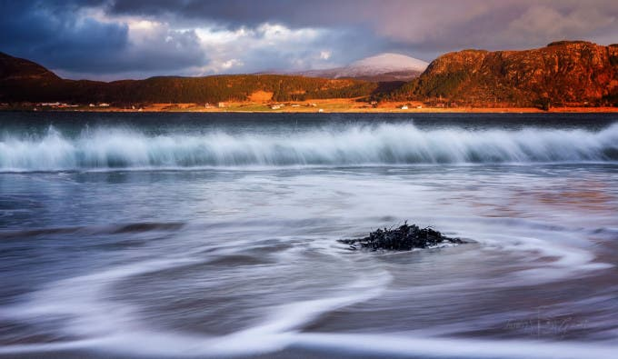 500px Photo ID: 111687451 - Throwback thursday, here is a shot from the winter when I went out to Lepsøya and to visit Hellevik, and along the way I took a few shots including Kjærstadsanden, and used a intervalometer to capture various shots of the waves crashing and receeding from the seaweed bundle left behind on the beach. Being on sand beaches makes me sentimental and sometimes homesick, everywhere Ive lived Ive been close to a nice sandbeach, except here in norway, I have to go quite a distance or take time to arrive at a beach I like and never warm enough for me to sunbathe to a sweat and then jump in the ocean for a quick swim to cool off and then repeat which is something I really miss. I also love waves, This is a single exposure and darkening the top of the shot and really brings forth the nice colors you sometimes get in the sunset, at the beginning of the time at the beach I got more golden colors but towards the time I left the beach the colors turned more to the pink side. the land you see straight ahead is Haramsøya and behind that is Flemsøya/Skuløya/Longva. I also made a logo for myself to include in my website hopefully be able to put on receipts, and maybe business cards in the future, Im also working on a timelapse from the last two years about the nights in norway and trying to make a better quality version than what I previously made. hope you guys like this one that has been sitting on my computer for a long time without seeing the public.