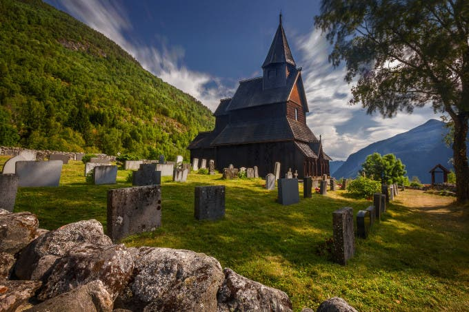 "500px Photo ID: 91716599 - One shot I love, that i re-edited for a stronger composition and mood. of course is best in large and black background Information about the church is at Which I copy and pasted the description from you to read if you wished to read. http://www.stavechurch.com/en/urnes/ you can follow me here or at https://www.facebook.com/artiwangroot Like, Favorite, Comment, Share, Enjoy! =D ""A stave church has been built three times on the same site here at Orneset. A hundred years would pass between the first and the third, the one we can visit today. The timber was felled in the years 1129-1130. On the long northern wall, original decorated sections from the demolished church have been used: the portal, wall planks and a corner post. The decorated gables from the same church are now covered to prevent wear and tear. The stave churches are Norway's unique contribution to the world's cultural heritage. Most were built between approx. 1130 and 1350, when the Black Death brought all new building to an end. Similar churches existed elsewhere in Europe, but only the Norwegian ones have survived. Of the original approx. 1,000 churches, 28 remain. Urnes stave church is the eldest and most highly decorated of them. In 1979 it was included on UNESCO's World Heritage List. In this description, we delve back to the time when the church was built, approx. 20 years before catholic Norway became a separate province under the Pope in Rome. Ownership of Urnes stave church was transferred to the Society for the Preservation of Norwegian Ancient Monuments in 1880. The society's logo is taken from the carved capitals inside the church."""