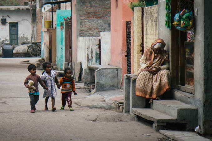 Naptime is over. Three children shopping for treats at a leprosy colony in Delhi, India.