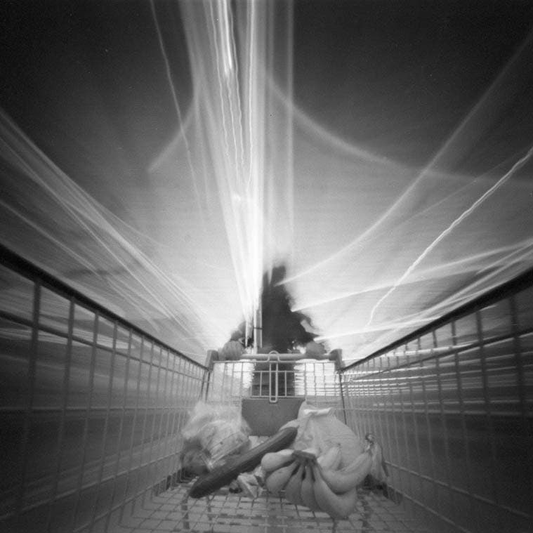 This Pinhole Photo Looks like an Angel Pulling a Shopping Cart