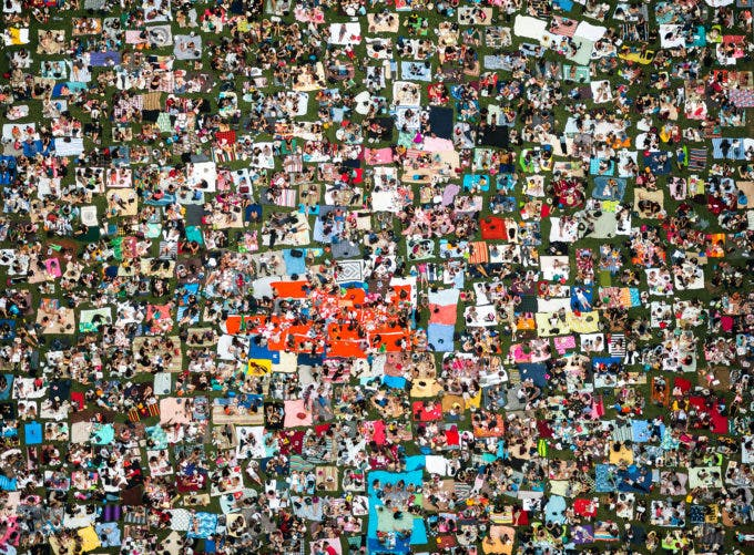 A sea of blankets in Bryant Park as spectators wait for a movie night to begin on a summer evening in NYC. I photographed this image from the rooftop of a 42-story building directly across the street from Bryant Park.