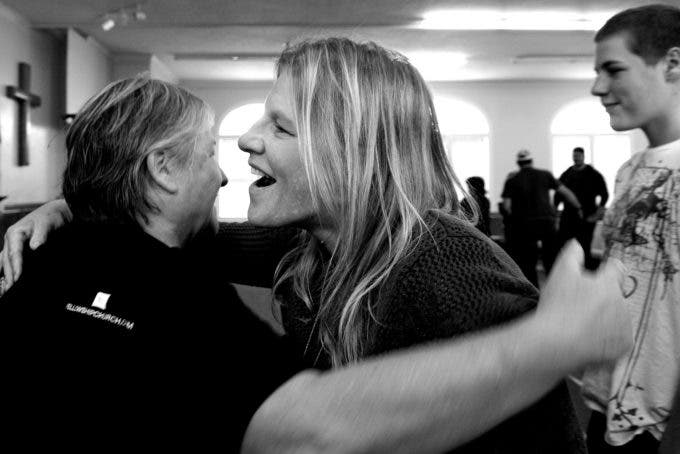 Photo by Christena Dowsett First Biker's Church members greet each other before a Sunday morning service in Texarkana, Texas.