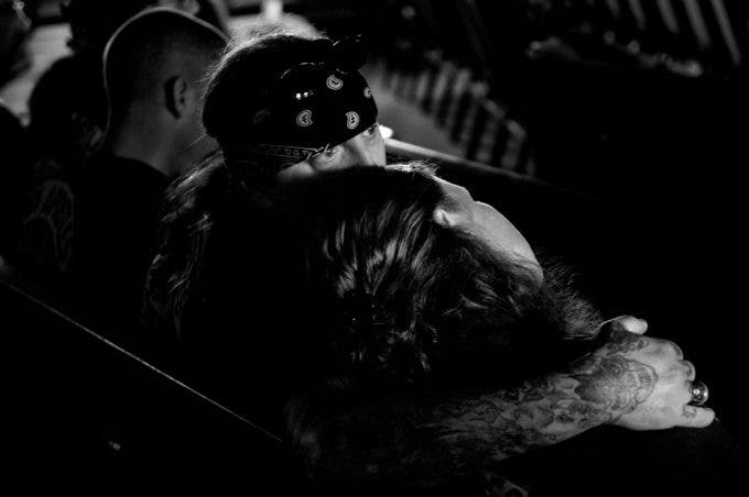 Photo by Christena Dowsett A couple embraces during church revival in Kilgore, Texas.
