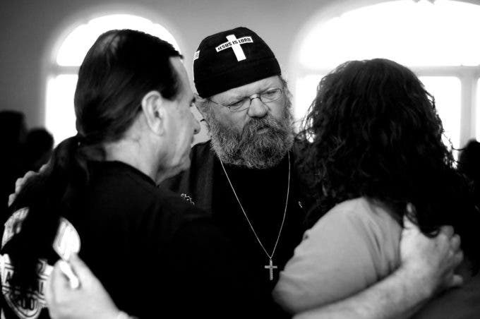 Photo by Christena Dowsett 1st Bikers Chruch Elder, Danny Taylor, prays with members of the church during a Sunday morning service in Texarkana, Texas.