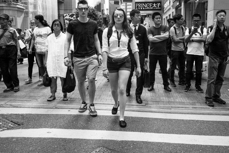 At the zebra crossing at Times Square, Hong Kong. Especially with this many people in the frame, it's very difficult to optimize the black and white tonal range of each figure while still optimizing contrast to reinforce visual emphasis of the main subject. As important as the main subject is, it shouldn't diminish the details of the supporting figures. Leica M246 + 35mm f/2 Summicron ASPH v2.