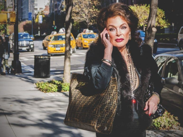 Name. Park Ave Woman. 2013. She's doing everything in her power to wear her money. If it weren't for the cell phone, this scene in this location could maybe have taken place for the past 100 years.