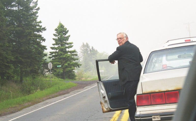 Name: Minnesota Fire. Taken: 1999. I was 18 or 19 when I took this on a road trip to northern Minnesota. Even at the time, I thought he looked from a few decades past. My father always had old rusted sedans like this. I thought this guy had a look of struggle in his face and think it captures the feeling of being Endangered.