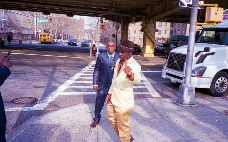 Name: Brooklyn Groom. Taken: 2016. It was the wedding day of the guy in the gold suit and his friends were taking wedding pictures. I included this photo in the book because of the finger their style and the culture it represents. They're in a tough part of town but looking like a million bucks and I wondered how time specific this photo will be in 10 or 50 years. Will people see this and know it's 2016? It's shot on film which ads a more nostalgic, older feel. I like the combo.