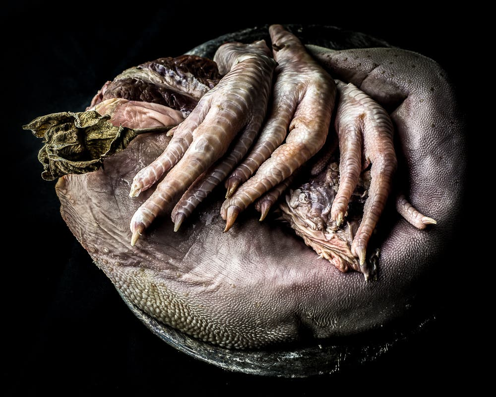 Neal Auch's Dark Food Photography Is a Slap in the Face to Factory Farming (NSFW)