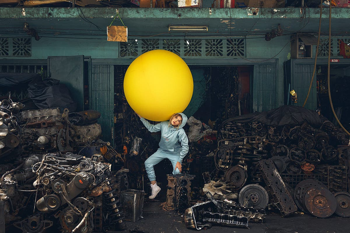 This Photo Series Puts a Woman and Her Giant Yellow Balloon in Bangkok