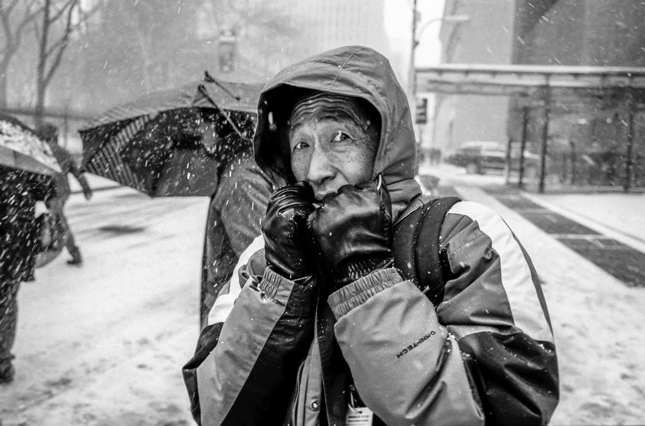 Adam Miller Shoots Street Photography with Flash in NYC's Blizzards
