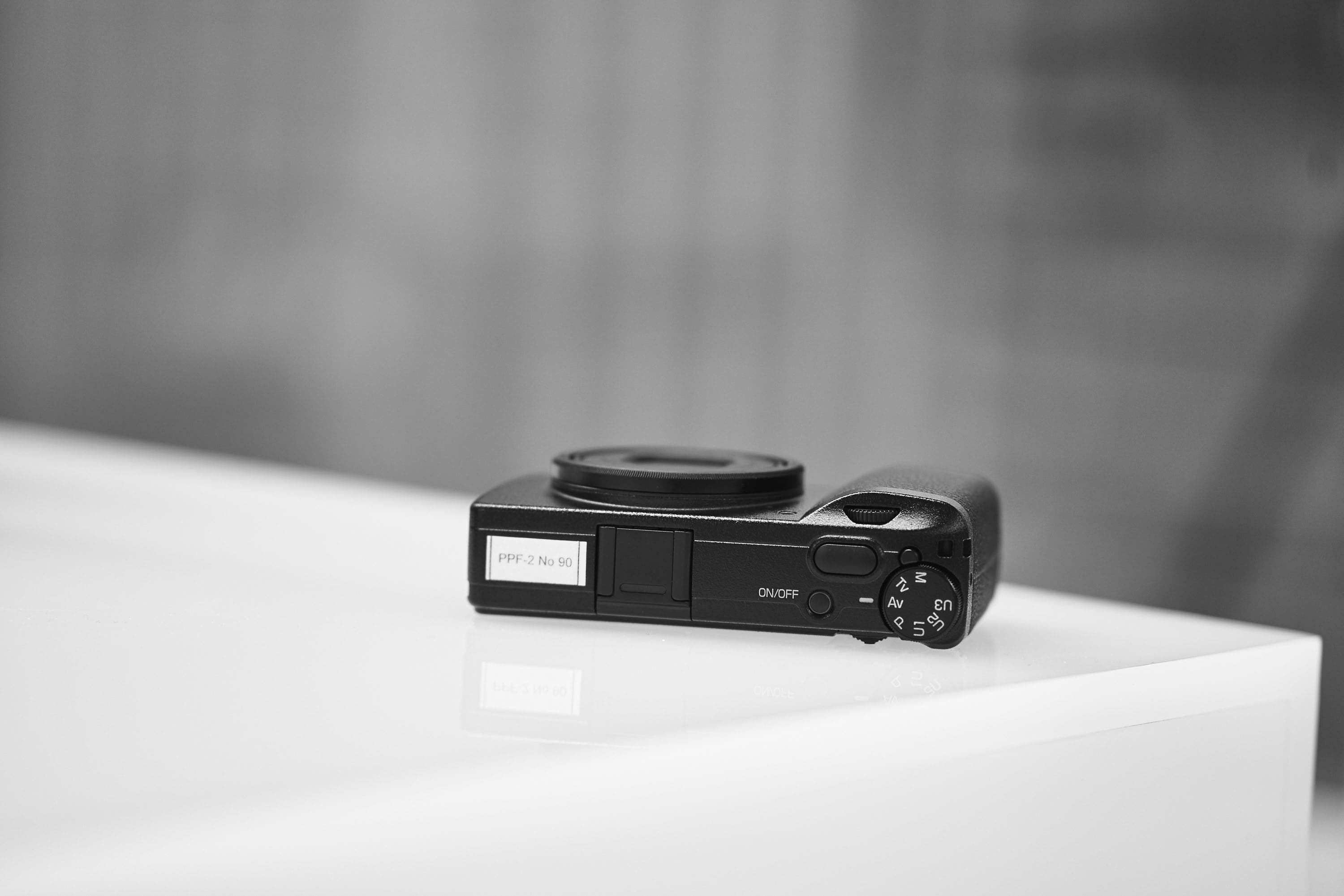 Here we see the top profile of the ricoh gr iii its a thin camera as you can see ricoh removed the pop up flash which is honestly sad to me