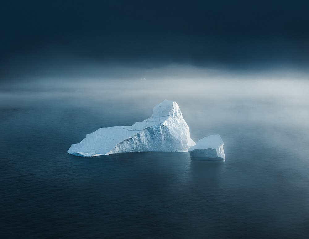 Icebergs Double as Floating Castles in Tom Hegen's Moody Series